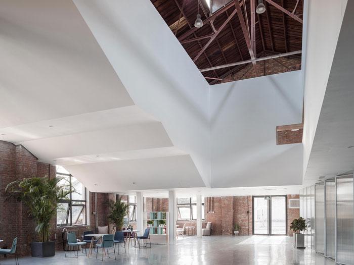厂房改造办公室进门区装修设计效果图